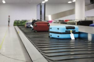 Luggage on conveyor belt in the airport waiting